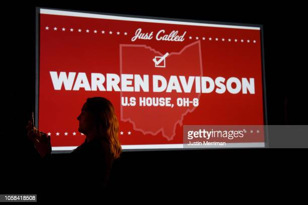 A woman takes a photo as the race for Ohio's 8th Congressional District race is called for Warren Davidson on November 6 2018 at the Ohio Republican...