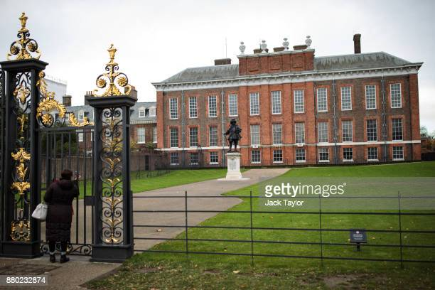 A woman takes a photo of Kensington Palace through the gates on November 24 2017 in London England The American actress Meghan Markle will live at...