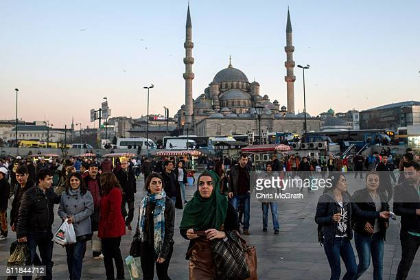 A woman takes a photograph in Eminonu on February 23 2016 in Istanbul Turkey Turkey's booming tourism industry is beginning to feel the effects of...