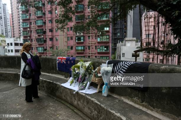 A woman takes a photograph of a small memorial after attending a special prayer for the victims of the Christchurch mass shooting in New Zealand at...