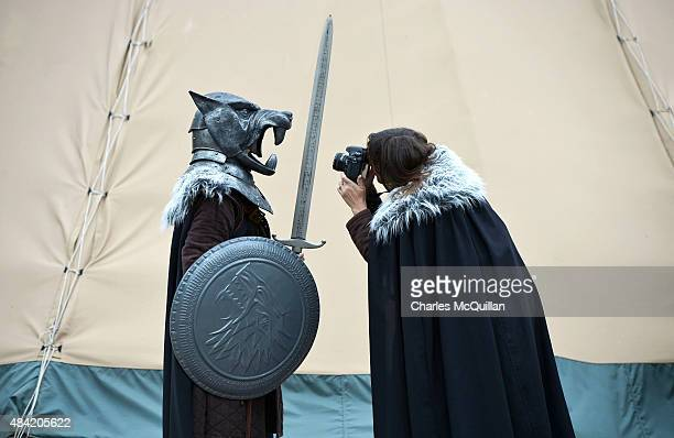 A woman takes a photograph of her son dressed in a Game of Thrones costume at Castle Ward on August 13 2015 in Belfast Northern Ireland According to...
