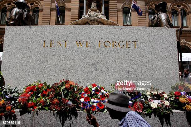A woman takes a photograph of the Cenotaph during the Remembrance Day Service held at Martin Place on November 11 2017 in Sydney Australia This year...