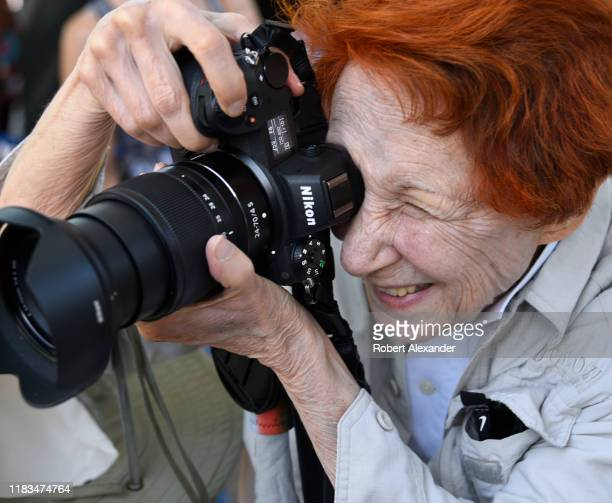 Woman takes a photograph with her Nikon camera in Santa Fe, New Mexico.