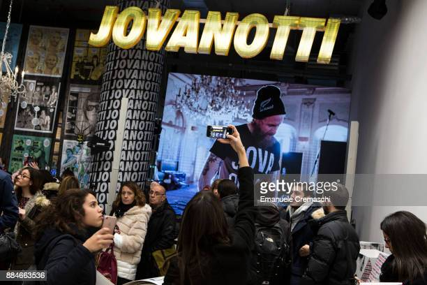 A woman takes a picture inside the 'Jova Pop Store' on December 1 2017 in Milan Italy Italian singer and songwriter Jovanotti opened a temporary...