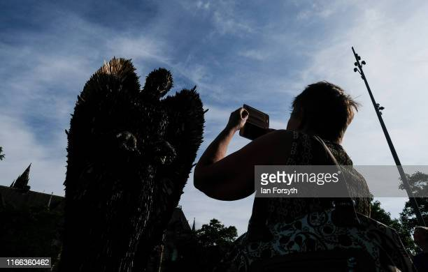 A woman takes a picture of the Knife Angel sculpture installed in the Centre Square in Middlesbrough on August 06 2019 in Middlesbrough England The...