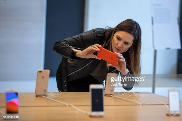 A woman takes a picture of the new iPhone 8 on display at Apple Regent Street during the phone's launch on September 22 2017 in London England Apple...