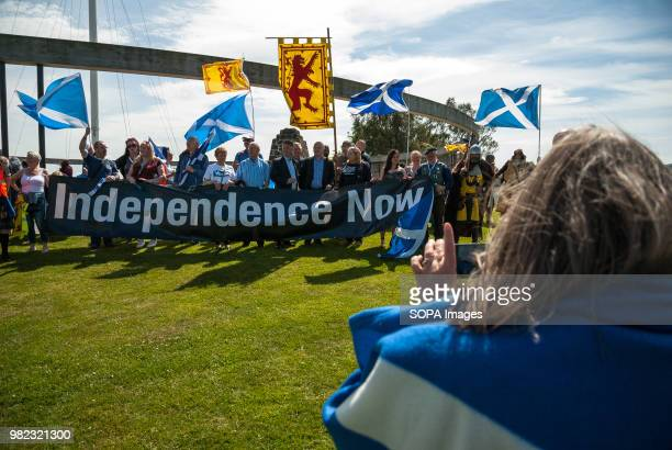 A woman takes a picture on her cellphone of the group that marched at the front of the event Thousands of Scottish independence supporters marched...