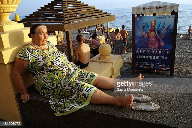 A woman takes a rest on the beach on July 21 2015 in Sochi Russia The Russian Black Sea resort of Sochi which hosted the 2014 Winter Olympics is...