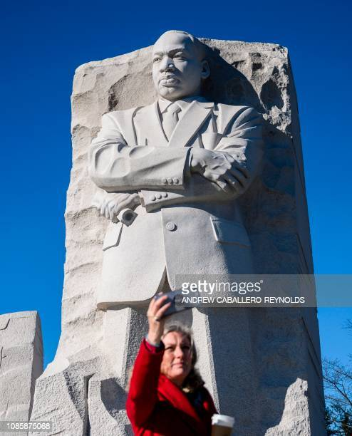 A woman takes a selfie as she visits the Martin Luther King Jr Memorial in Washington DC on Martin Luther King Day on January 21 2019