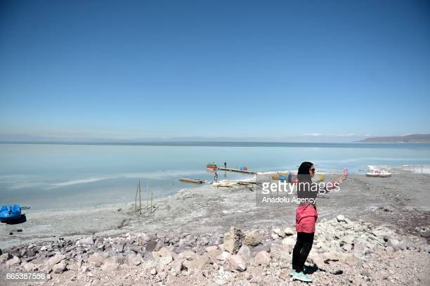 A woman takes a selfie at Urmia Lake in Urmia Iran on April 6 2017 Urmia Lake was the largest lake in the Middle East and the sixthlargest saltwater...