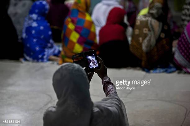 A woman takes a selfie before prayers at Baitul Mukarram the National Mosque on Eid AlFitr July 18 2015 in Dhaka Bangladesh Muslims around the world...