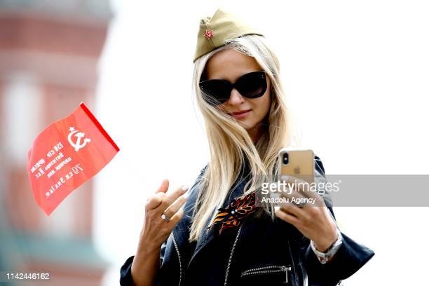 A woman takes a selfie during a Victory Day military parade marking the 74th anniversary of the victory over Nazi Germany in the 19411945 Great...