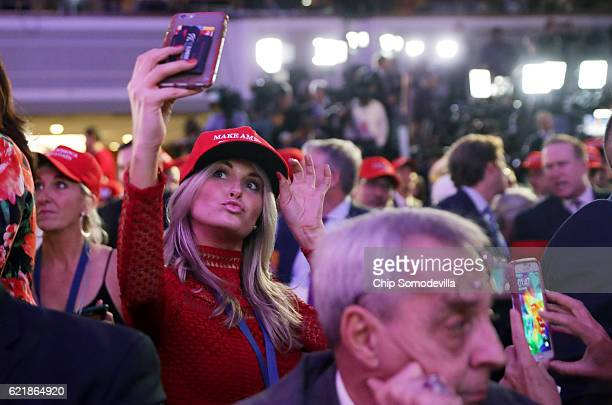 A woman takes a selfie during Republican presidential nominee Donald Trump's election night event at the New York Hilton Midtown on November 8 2016...