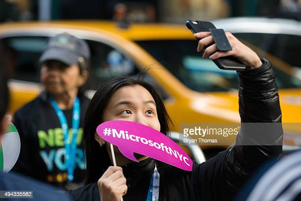 A woman takes a 'selfie' while waiting in line for the grand opening of Microsoft's first flagship store on Fifth Avenue on October 26 2015 in New...