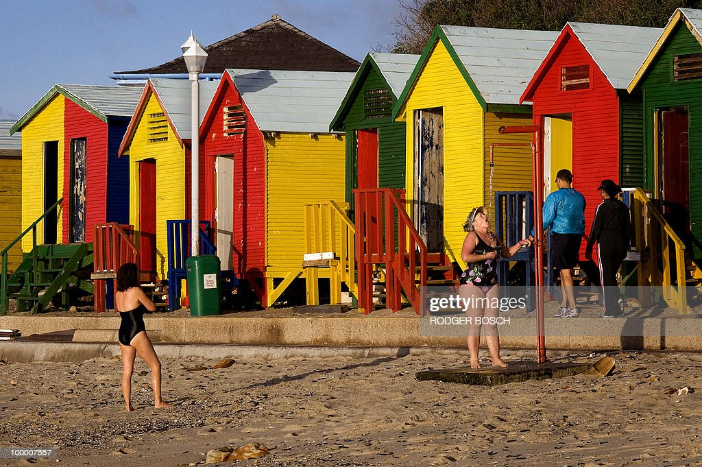 A woman takes a shower, after swimming, at St James Beach on May 19, 2010 in Muizemberg on the outskirts of Cape Town, South Africa. South Africa will host the FIFA World Cup from the 11 of June to the 11 of July, 2010.