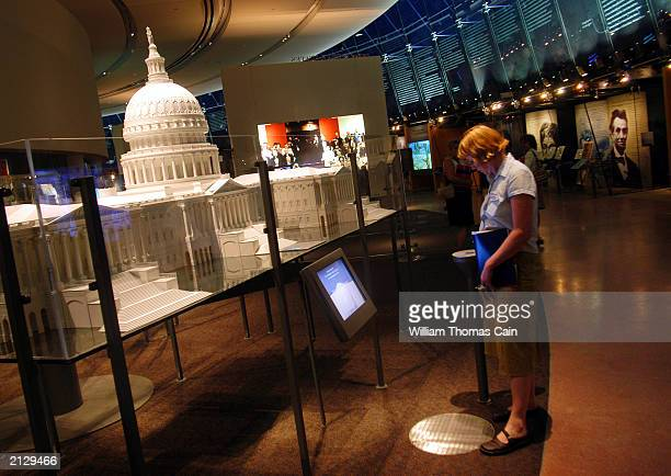 Woman takes a virtual tour of the U.S. Capitol during a preview of the National Constitution Center July 1, 2003 in Philadelphia, Pennsylvania. The...