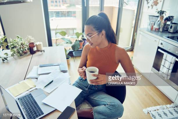 woman takes care about finances - tax stock pictures, royalty-free photos & images