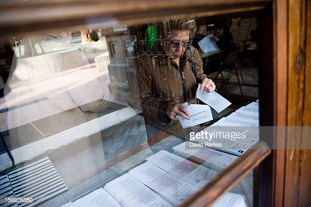 A woman takes her ballot for regional elections held in Catalunya on November 25 2012 in Barcelona Spain Over five million Catalans will be voting in...