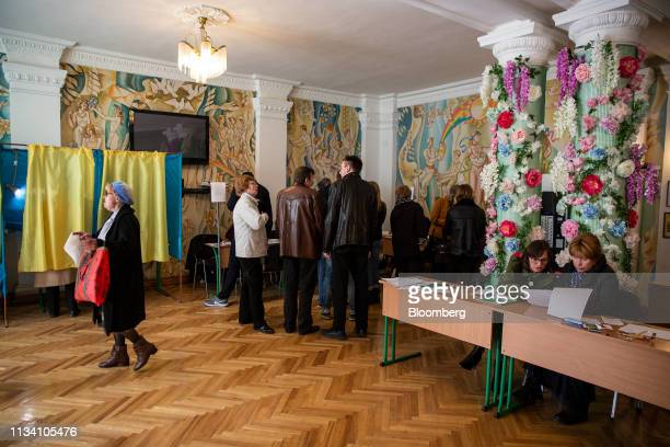 A woman takes her ballot to a voting booth at a polling station in Kiev Ukraine on Sunday March 31 2019 Ukrainians will choose between a field of...
