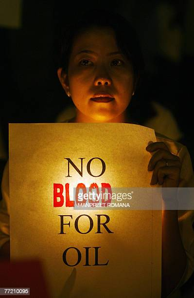 A Woman Takes Part In A Candle Light Vigil At India Gate In Support Of Myanmar