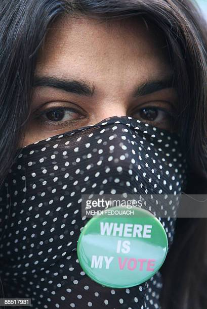 A woman takes part in a demonstration of hundreds of people on June 16 2009 in front of the Iranian embassy in Paris to protest against Iranian...