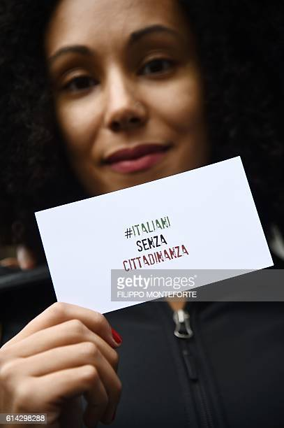 A woman takes part in a demonstration to ask for a reform of the citizenship law in Italy on October 13 2016 in Rome The Italian Democratic Party...