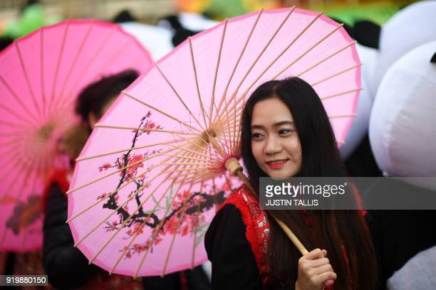 A woman takes part in a parade to celebrate the Chinese Lunar New Year in central London on February 18 2018 The Chinese Lunar New Year on February...