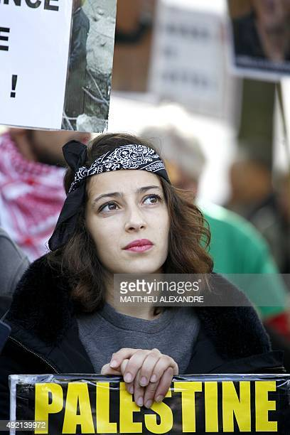 A woman takes part in a proPalestinian demonstration on October 10 2015 in Paris calling for a boycott of Israel and for the recognition of the State...