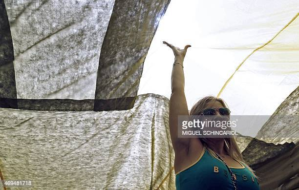 A woman takes part in a protest against the government of Brazilian President Dilma Rousseff in Sao Paulo Brazil on April 12 2015 Thousands in Brazil...