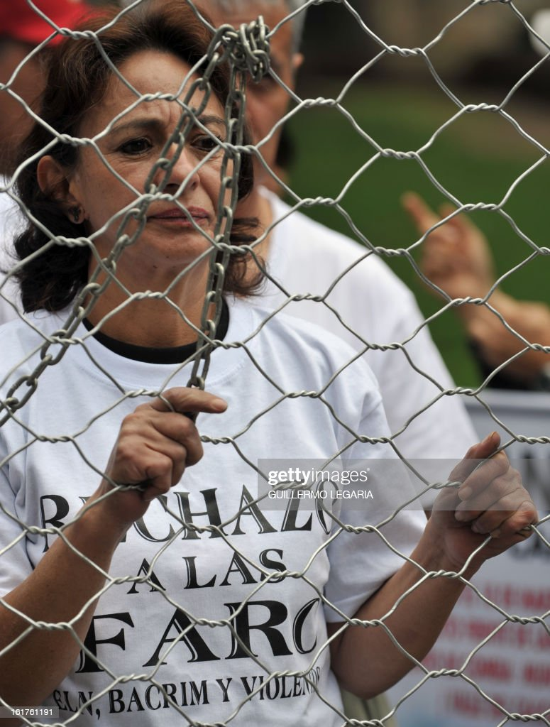 A woman takes part in a protest against the Revolutionary Armed Forces of Colombia (FARC) guerrillas and to ask for the release of hostages on February 15, 2013 in Bogota, Colombia. The protest aims to reject the latest terrorist attacks and abductions of civil and military people while the guerrillas hold peace negotiations with the government in Havana, Cuba. AFP PHOTO/Guillermo LEGARIA