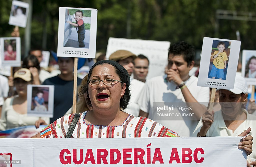 A woman takes part in a protest against those responsible for the deaths of dozens of children in a day care center fire along Reforma Avenue in Mexico City on June 5, 2010. Relatives of 49 children killed in a fire at a day care center a year ago in Hermosillo, Mexico, demanded that officials - who failed to ensure the center's safety - be brought to justice. AFP PHOTO/Ronaldo Schemidt