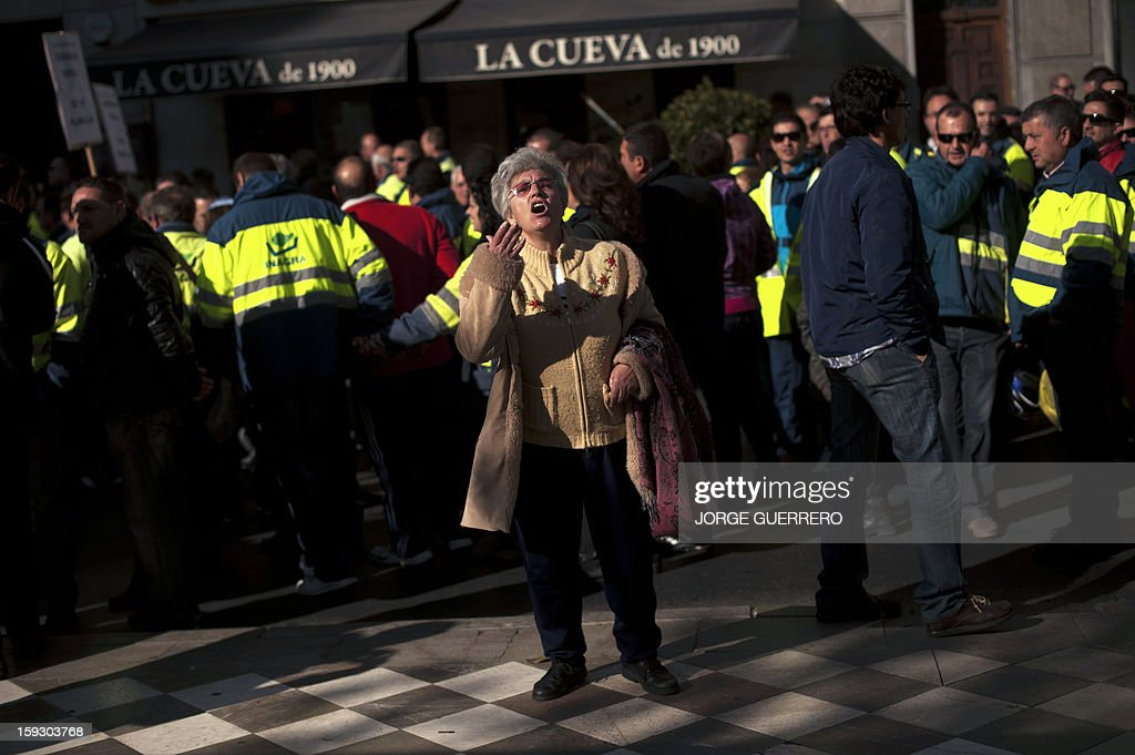 A woman takes part in a protest organized by employees of the cleaning company INAGRA (Grenade Environmental Engineering) against austerity cuts in Granada on January 11, 2013. Rubbish collectors have been on strike in the municipality of Granada to protest against the austerity cuts imposed by the town hall.