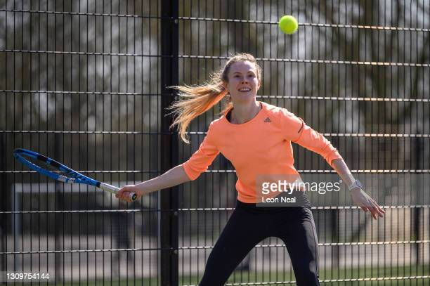 Woman takes part in a tennis lesson at Highbury Fields tennis courts on March 29, 2021 in London, England. Today the government eased its rules...