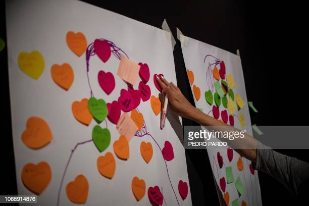 A woman takes part in a workshop on sexting safely and responsibly in Mexico City on August 27 2018 The workshop encourages participants to view...