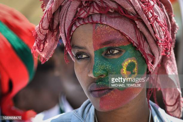 TOPSHOT A woman takes part in celebrations for the return of the formerly banned antigovernment group the Oromo Liberation Front at Mesquel Square in...