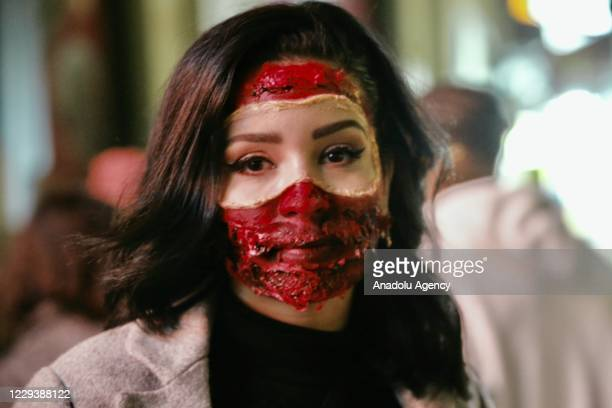 Woman takes part in Halloween celebrations in London, United Kingdom on November 01, 2020. People dress and use make-up to make themselves look like...
