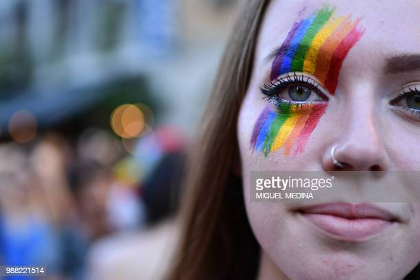 Woman takes part in the annual Lesbian, Gay, Bisexual and Transgender Pride Parade in Milan, on June 30, 2015.