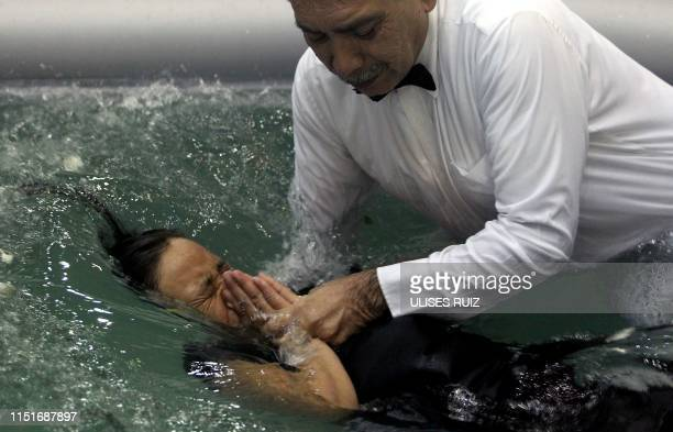 A woman takes part in the baptism day of the 'La Luz Del Mundo' church in Guadalajara State of Jalisco Mexico on June 23 2019 The international...