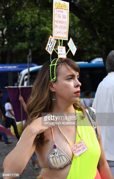 A woman takes part in the commemoration of the International Women's Day at Candelaria square in Rio de Janeiro Brazil on March 8 2017 The...