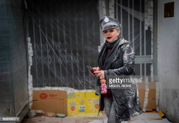 A woman takes part in the 'Domingo Fareleiro' festival in the village of Xinzo de Limia northwestern Spain on January 21 2018 / AFP PHOTO / MIGUEL...