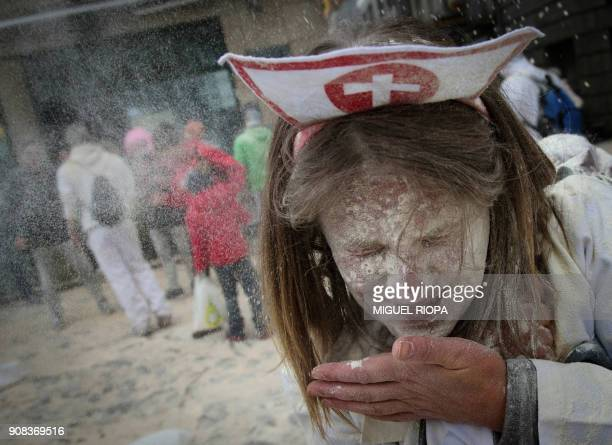 TOPSHOT A woman takes part in the 'Domingo Fareleiro' festival in the village of Xinzo de Limia northwestern Spain on January 21 2018 / AFP PHOTO /...