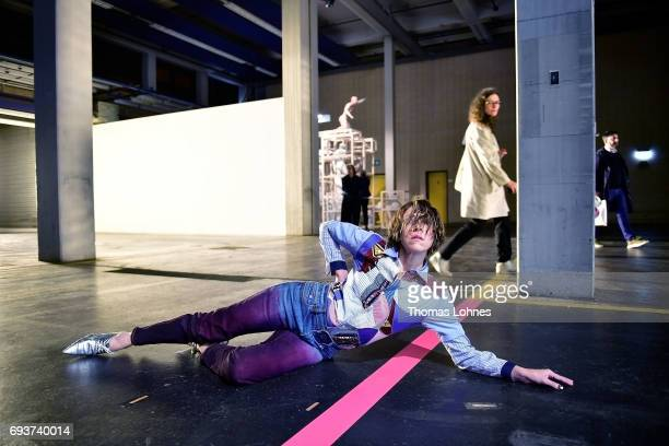 A woman takes part in the performance 'Staging' by the artist Maria Hassabi at 'Neue Neue Galerie' on June 8 2017 in Kassel Germany The documenta 14...
