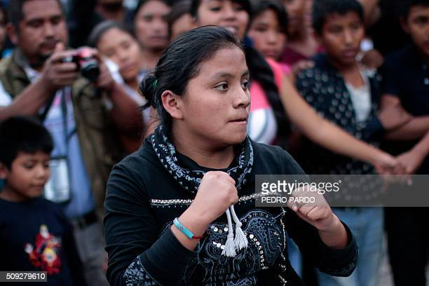 A woman takes part in the traditional Xochimilcas fight to defend their women against the Aztecs in the Mexican municipality of Zitlala in Guerrero...