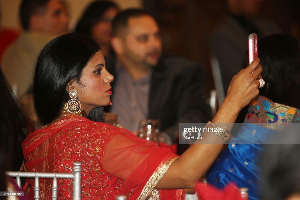 Woman takes photos during a fashion show during the Diwali Gala Celebration in Mississauga Ontario Canada on 25 November 2017 This luxurious gala...