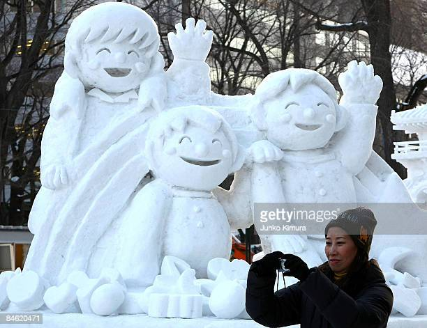 Woman takes photos of ice sculptures ahead of the opening of the 60th Sapporo Snow Festival at Odori Park on February 4, 2009 in Sapporo, Japan. The...