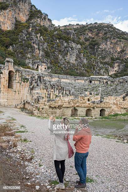 Woman takes smart phone pic of ancient Greek ruin