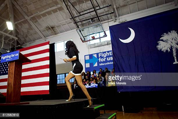 A woman takes the stage to give a speech to the crowd before Democratic Presidential candidate former Secretary of State Hillary Clinton held a rally...
