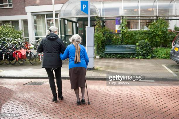 Woman taking a 101-year old woman home