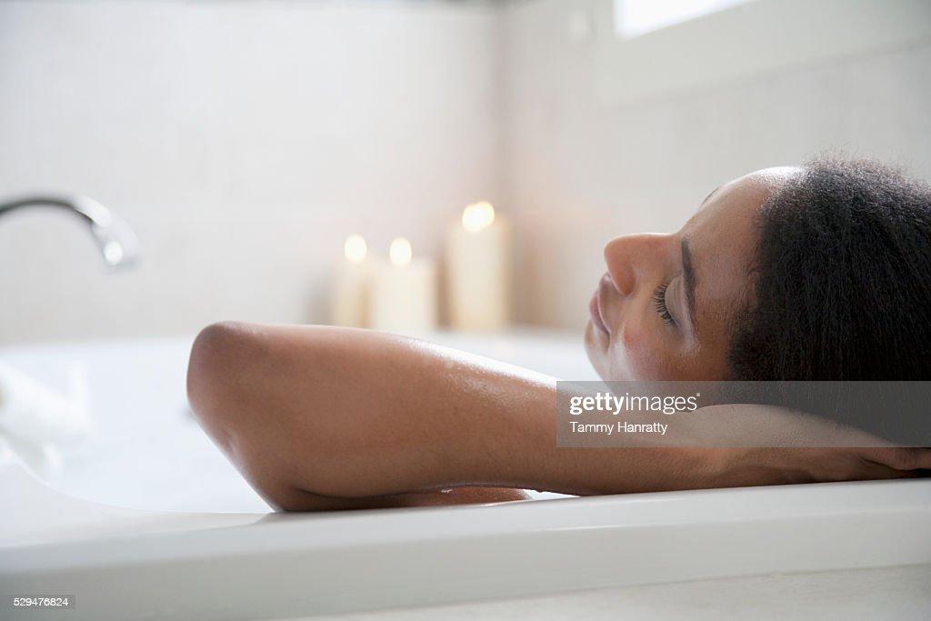 Woman taking a bath : Stock Photo