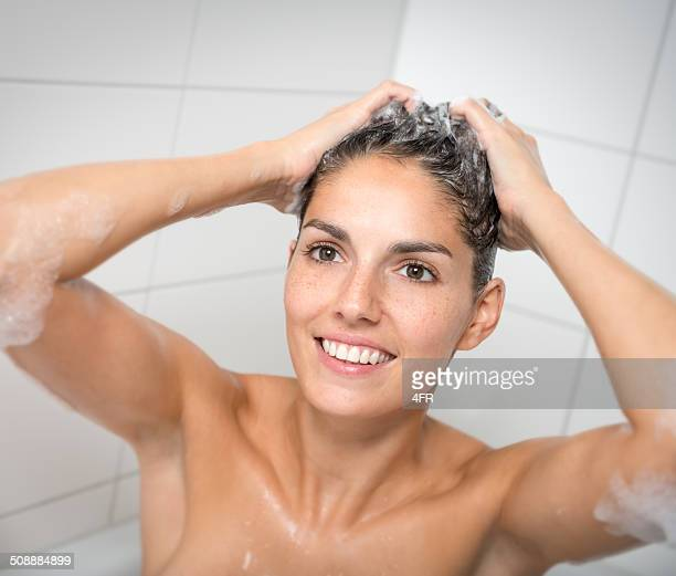 woman taking a bath washing her hair - washing hair stock pictures, royalty-free photos & images